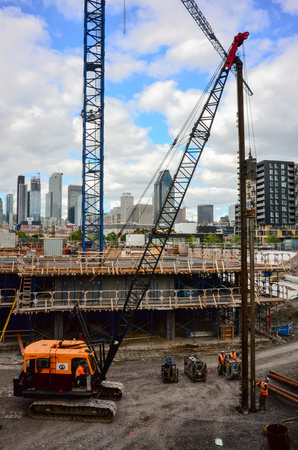 MONTREAL, CANADA - SEPTEMBER 02 2016:Constructon workers erecting steel beam for residential building in Montreal downtown.Work is fast executed to comply with the booming market.