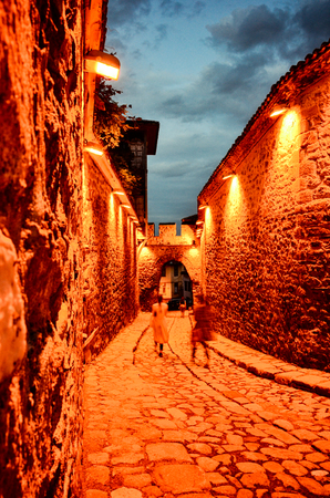 Small stone street in old roman city of Plovdiv at night