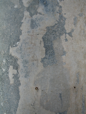 Concrete wall with old paint that