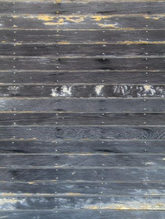 Rough textured old wooden wall with chipped paint photo