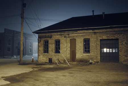 Abandoned Brick Building at Night photo