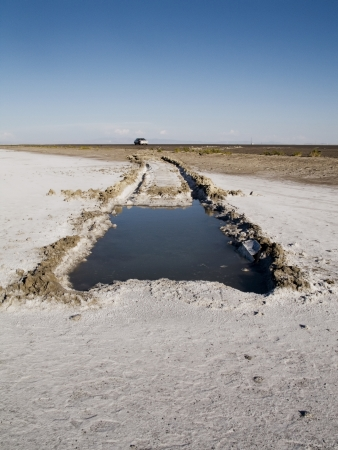Hole exposed in Great Salt Lake Desert after vehicle wreck