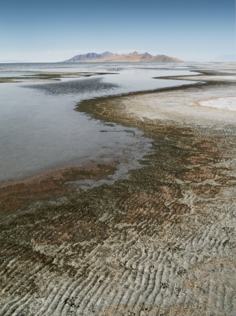 The Great Salt Lake shoreline with Antelope Island State Park in the distance Stock fotó