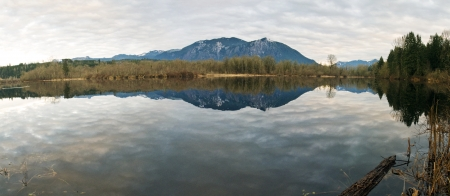 Panorama of pond on Southeast Mill Pond Road in Snoqualmie, Washington with Cascade mountains in background  Stock fotó