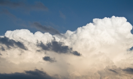 Storm clouds on dark blue sky