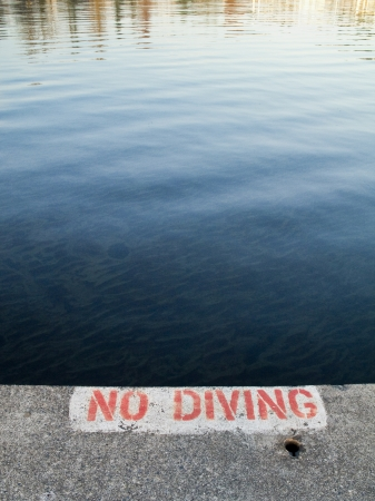 no diving sign: No diving sign painted on concrete overlooking Lake Washington in Kirkland, Washington