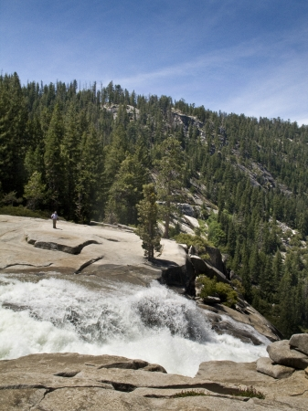 Photo taken above Nevada Falls as the water goes over the cliff during the summer time in Yosemite
