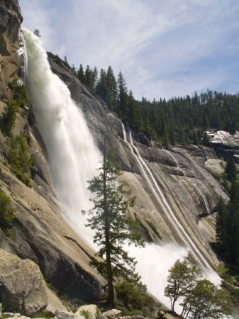Photo taken below Nevada Falls as the water goes over the cliff during the summer time in Yosemite