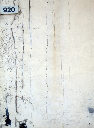 Concrete wall with rough textured concrete with cracks Stock fotó