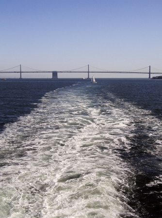 Boat wake with Bay Bridge in background