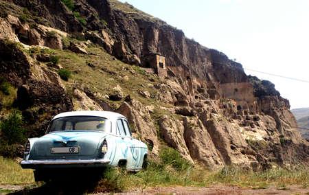 russian car: Old broken-down russian car in the georgian medieval village of Vardzia
