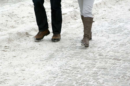 cobbled: Walking in the snow Stock Photo