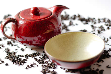Red china teaset with loose tea photo