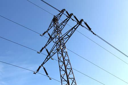 Power line tower against blue sky Stock Photo - 13193810