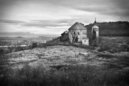 Black and white photo of countryside with old church photo