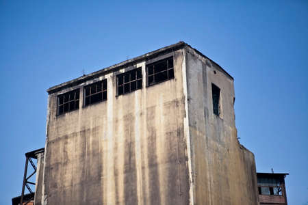 steel mill: Old abandoned concrete building against blue sky in former steel mill in Ostrava, Czech Republic Stock Photo