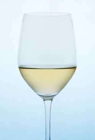 White wine on blue gradient background. Stock Photo