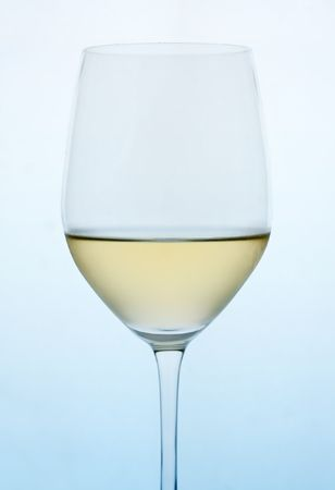 White wine on blue gradient background. Stock Photo