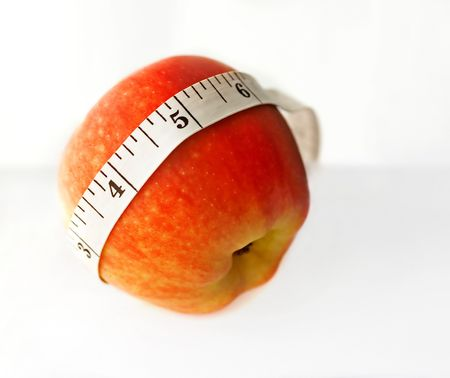 Healthy Choice, an apple with measuring tape. Stock Photo