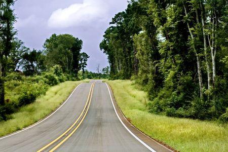 Long road in Louisiana. Stock Photo