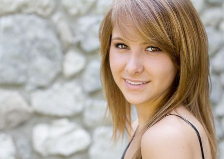 Closeup portrait of a beautiful young lady smiling. Stock Photo