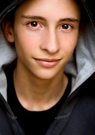 Closeup portrait of a young man smiling.