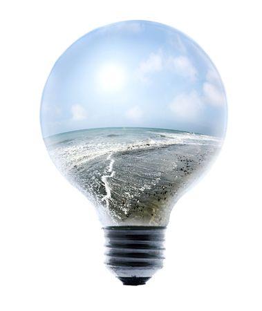 Clean Energy, ocean and bright sky inside a lightbulb