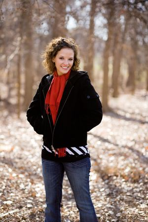 Portrait of a beautiful young woman smiling with winter clothing.