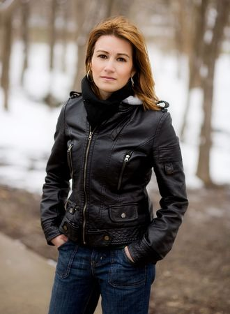 Portrait of a beautiful young woman in winter