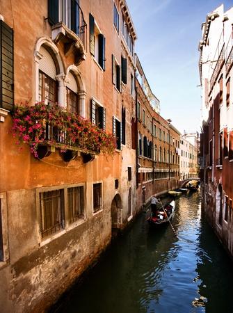 Venice, Gondola ride in a romantic small canal