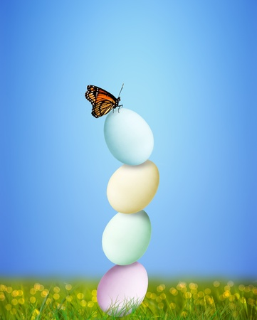 Colorful Easter eggs balancing with butterfly on top