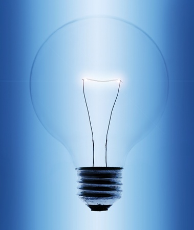 Light bulb close-up on blue gradient background Stock Photo