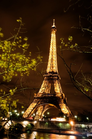 Paris, France, November 12, 2010 - The Eiffel tower lit at night in Paris, France. The most visited monument of France.