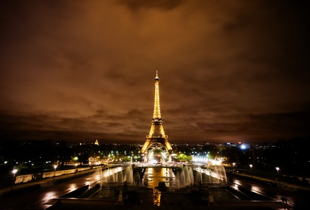 Paris, France, November 12, 2010 - The Eiffel tower lit at night in Paris, France. The most visited monument of France. Stock Photo - 8857432