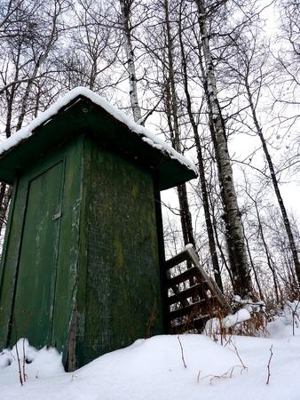 緑の小屋は、家族 agcreage で撮影します。 写真素材