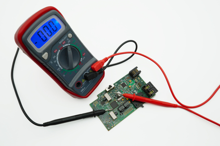 electronic components, multimeter isolated on white background Stock Photo