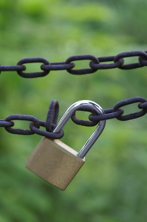 Close up of a locked padlock photo