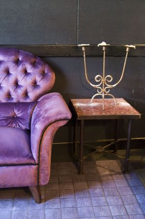A violet armchair at Amadeus Bar Stock Photo