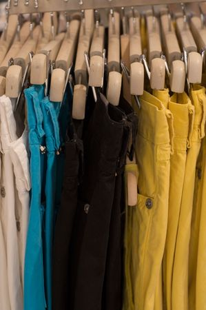 showed: Some pants colored showed in a shop