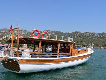 A gulket parked in the mediterranean port of kas photo