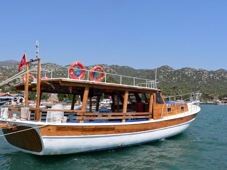 A gulket parked in the mediterranean port of kas