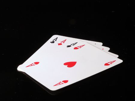 achivement: Four aces meaning poker in a black background Stock Photo