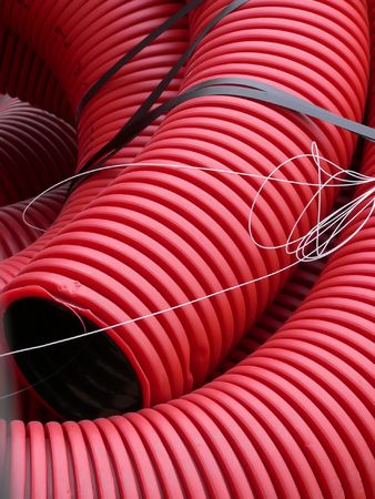 pliable: Red curvilinear tubes for construction Stock Photo