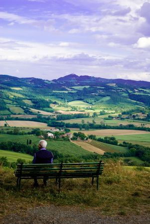 contemplates: An old man contemplates the beautifl landscape in front of him, Umbria Italy