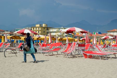 faked: Illegal african seller in a beach of Italy with faked items