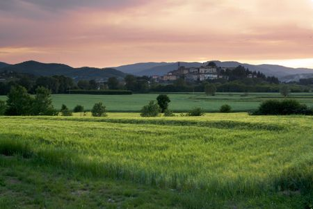 The town of Monterchi in Umbria is represented here on the backgroung with some fields in front of her at sunset
