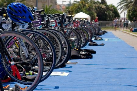 Group of Bikes wheels in a row  in a triathlon competition.