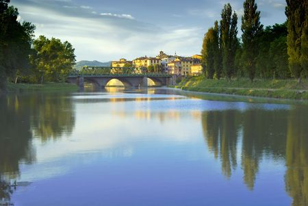 meets: Tevere river meets a bridge in the old town of Umbertide, Umbria