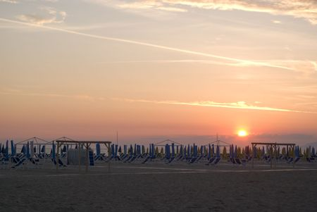 blu sky: Postcard style image of a beach in italy at sunset.