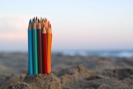 Color pencils in the sand. Stock Photo - 1298547